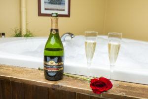 champagne on a tub ledge