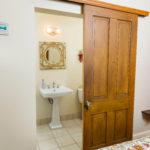 bathroom sliding door from bedroom