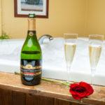champagne by bathroom tub