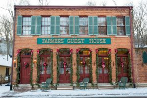 view of exterior of farmers guest house during snowy weather