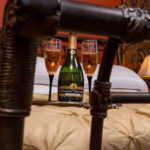 champagne on bed