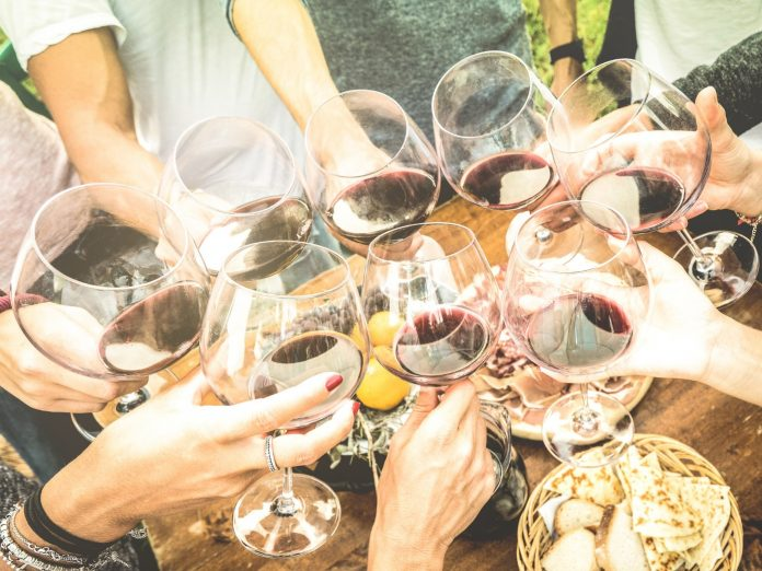people toasting with wine
