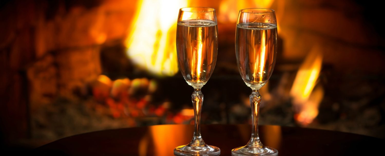 champagne glasses by fire