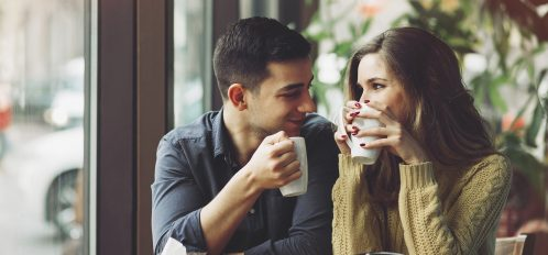 couple drinking coffee together; things to do in galena IL in the fall