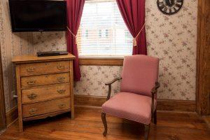 chair, dresser, television