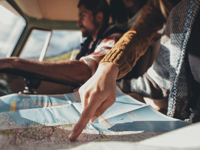 road trip, omaha to galena, pointing at map in car
