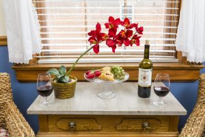 jennie suite at farmers guest house, flowers, wine glass, snacks