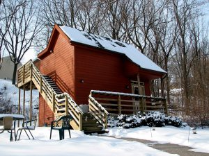 annie's galena cottage exterior with snow